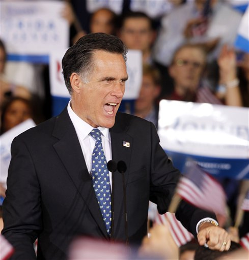 Mitt Romney reacts to supporters at his Florida primary night rally in Tampa on Tuesday.