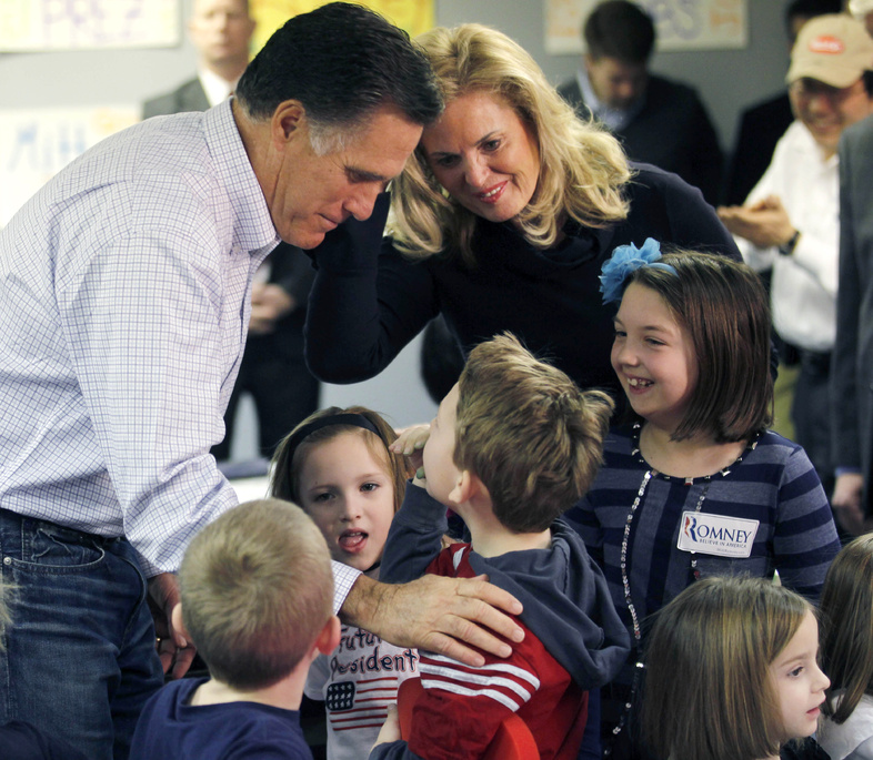 Republican presidential candidate, former Massachusetts Gov. Mitt Romney, and his wife Ann, greet children of campaign volunteers as they visit a campaign call center in Livonia, Mich., on Tuesday.