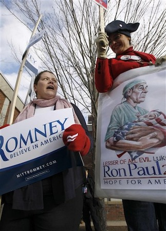 A supporter of Republican presidential candidate, Rep. Ron Paul, right, argues with a supporter of Republican presidential candidate Mitt Romney (AP Photo/Charles Dharapak).