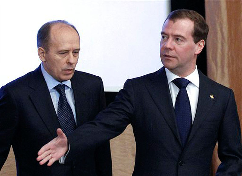In this Tuesday, Feb. 7 photo, Russian President Dmitry Medvedev, right, and Federal Security Service Chief Alexander Bortnikov attend a meeting with top officials of the Federal Security Service (FSB) in Moscow. The FSB said Friday that Russian military officer Lt.-Col. Vladimir Nesterets pleaded guilty to charges of passing classified data to the CIA for money, and was sentenced to 13-years in prison. (AP Photo/RIA -Novosti, Dmitry Astakhov, Presidential Press Service)