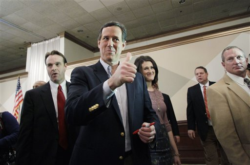 Republican presidential candidate Rick Santorum gives a thumbs up to a supporter at the Livonia Chamber of Commerce breakfast today in Livonia, Mich.