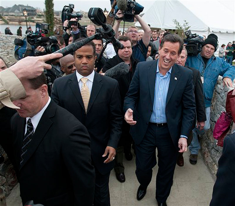 Republican presidential candidate Rick Santorum leaves after speaking at the Bella Donna Chapel in McKinney, Texas, Wednesday, Feb. 8, 2012. (AP Photo/Rex C. Curry)