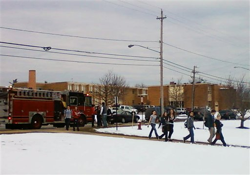 People are evacuated from Chardon High School in Chardon, Ohio, about 30 miles east of Cleveland, after a number of students were shot at the beginning of the school day today.