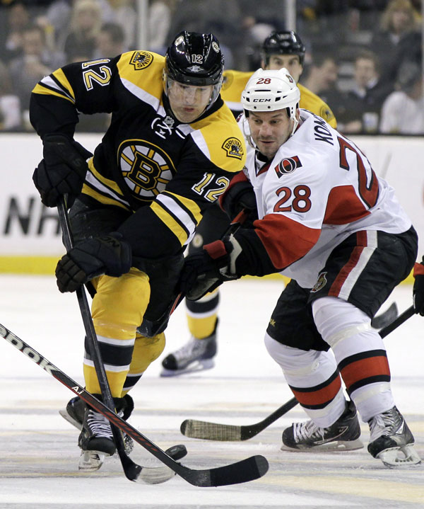 NEW ACQUISITION: Boston Bruins left wing Brian Rolston, left, controls the puck past Ottawa Senators center Zenon Konopka during the second period of their game Tuesday night in Boston. The Bruins lost 1-0.