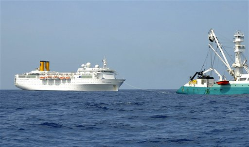In this photo taken by a member of French fishing vessel, The Talenduic, and provided by the Prefecture of the Reunion Island, shows the Italian cruise ship, The Costa Allegra, left, being towed by French fishing vessel, The Trevignon, in the Indian Ocean today.