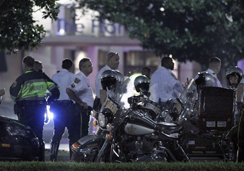 Police gather outside The Florida Mall in Orlando, Fla. late Thursday, Feb. 23, 2012 after more than 100 sheriff's deputies in riot gear broke up an out-of-control crowd waiting to buy a new Nike basketball shoe at one of the stores. (AP Photo/Reinhold Matay)