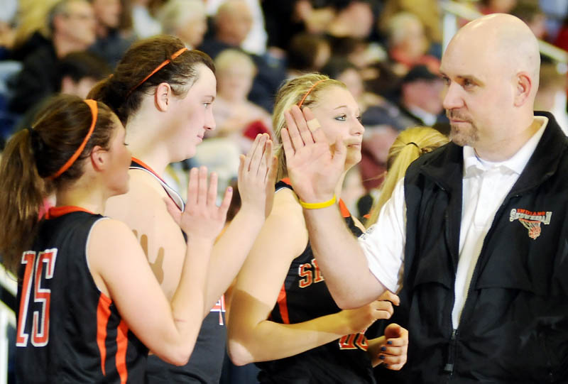 GOOD RUN: Skowhegan Area High School girls basketball coach Heath Cowan high-fives his bench as the clock ticks down during an Eastern Maine Class A semifinal Wednesday at the Augusta Civic Center. Skowhegan lost 54-34.