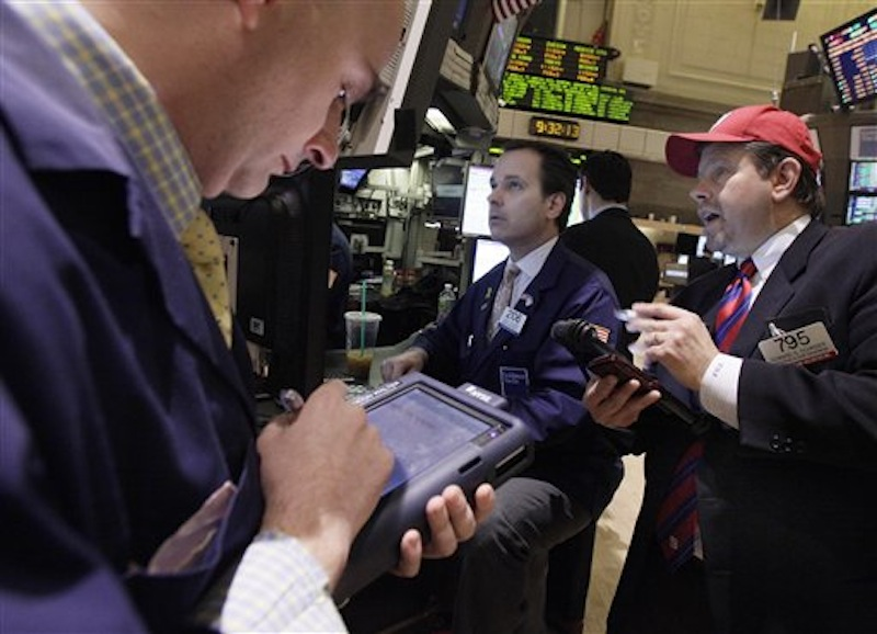 Trader Edward Schreier, right, works with specialist John Alatzas, center, on the floor of the New York Stock Exchange today.