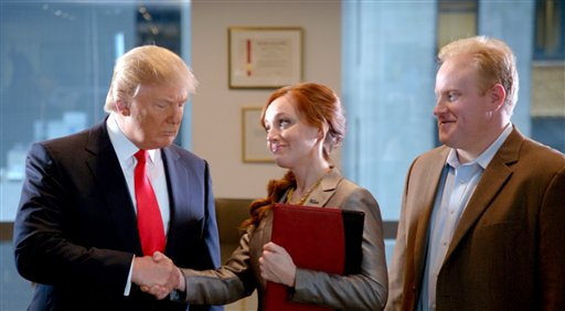"""A scene from the ad """"Smarter, Bolder, Faster,"""" with a Century 21 saleswoman and real estate tycoon Donald Trump, left. The ad aired during Super Bowl on Sunday."""