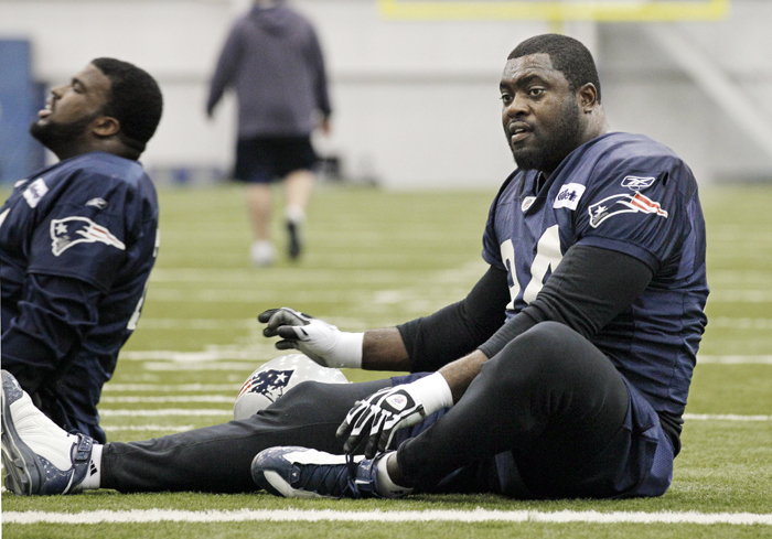 New England Patriots defensive end Shaun Ellis stretches during practice on Wednesday in Indianapolis.