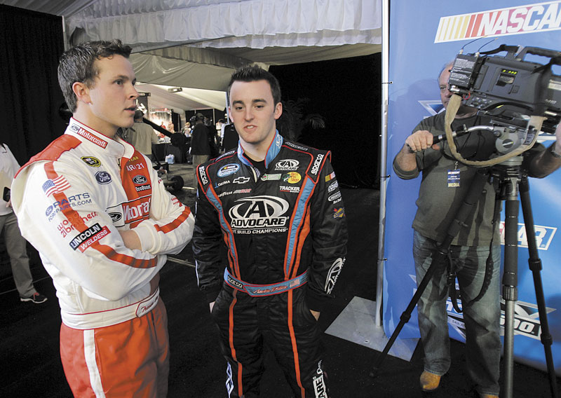 STILL ON THE OUTS: Despite winning last year's Daytona 500, Trevor Bayne, left, still does not have a full-time Sprint Cup or Nationwide Series ride. Bayne is shown talking to fellow driver Austin Dillon during media day Thursday at Daytona International Speedway in Daytona Beach, Fla.