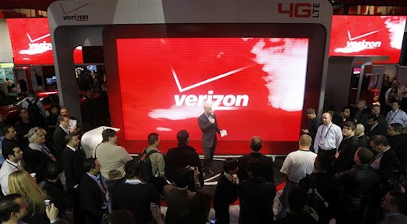 In this Jan. 6 photo, attendees check out the unveiling of 4G devices at the Verizon booth during the Consumer Electronics Show, in Las Vegas. Challenging Netflix, Verizon said Monday, Feb. 6, 2012, it will start a video streaming service later this year in cooperation with Redbox and its DVD rental kiosks. (AP Photo/Isaac Brekken)