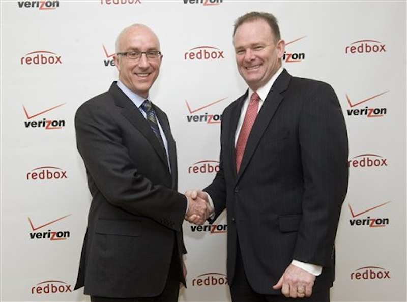 Bob Mudge, right, president of Verizon Consumer, and Paul Davis, CEO of Coinstar, Inc. announced Monday, Feb. 6 in New York a joint venture that delivers a combination of Redbox entertainment options with an on-demand streaming service from Verizon, Inc. (Diane Bondareff/AP)
