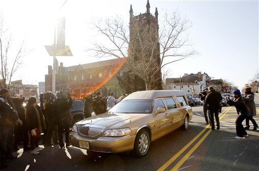 The hearse carrying the body of Whitney Houston leaves Whigham Funeral Home in Newark, N.J. for a short ride to the New Hope Baptist Church for her funeral Saturday, Feb. 18, 2012. (AP Photo/Rich Schultz)