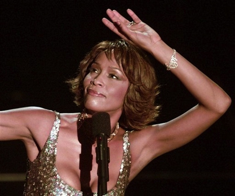 "In this April 10, 2000 file photo, entertainer Whitney Houston strikes a pose during her performance at the Shrine Auditorium in Los Angeles during taping of the ""25 Years of #1 Hits: Arista Records' Anniversary Celebration."" (AP Photo/Mark J.Terrill, file)"