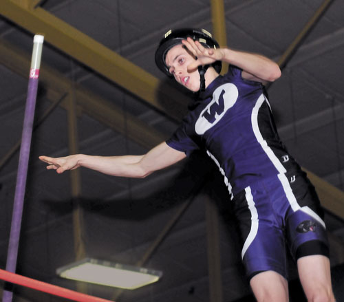 UP AND OVER: Waterville's Devin Burgess won the Class B state championship in the pole vault with a leap of 13-feet on Monday in Bates College in Lewiston.