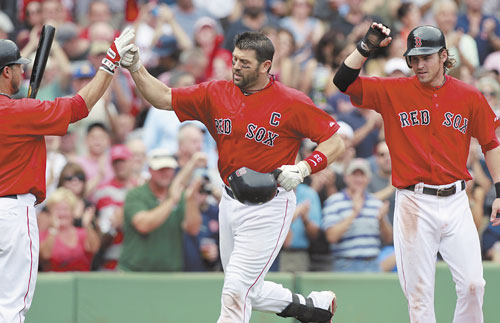 Red Sox catcher Jason Varitek, center, celebrates a two-run homer last year against Oakland. It's possible the beloved team captain has played his last game with the Red Sox.