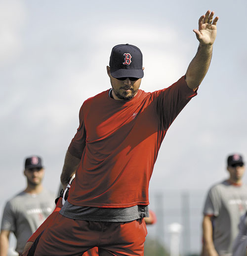 GETTING READY: Boston Red Sox pitcher Josh Beckett works out as pitchers and catchers officially report to spring training Sunday in Fort Myers, Fla.