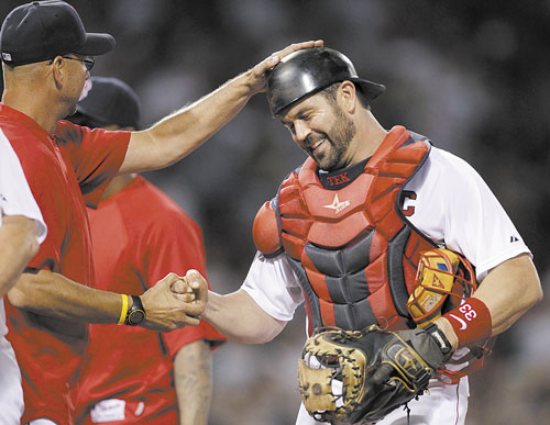 CALLING IT A CAREER: For 15 years, Jason Varitek, right, was the voice in the Boston pitching staff's ear, and the target behind the plate, giving the Red Sox their hard-nosed, gritty identity that they used to win two World Series titles. Now, it appears that era has come to an end.