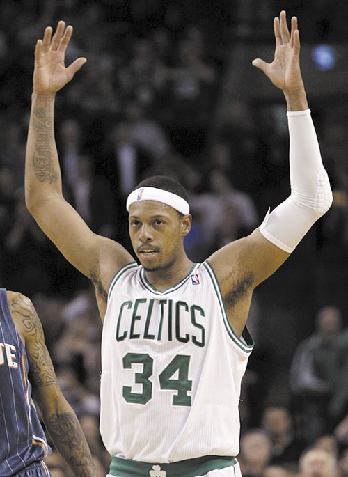 MOVING UP: Boston forward Paul Pierce acknowledges the crowd after passing Larry Bird for the No. 2 spot on the team's career scoring list, during the second half against the Charlotte Bobcats on Tuesday in Boston.