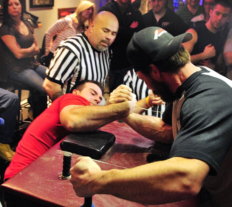 Matt Bouchard, left, of Caribou, and Malcolm Tashjian, of Salem, NH, compete in a 177-198 pound match at the Maine State Arm Wrestling Championships on Saturday night at the Pond Town Tavern in Winthrop.