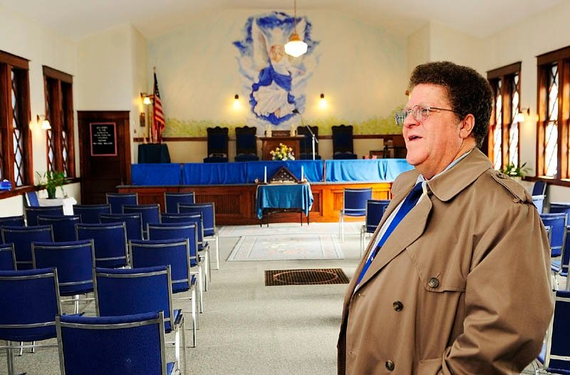 READY TO GO: The Rev. Earl Wallace talks about plans to move the Augusta Spiritualist Church from Perham Street in Augusta during an interview there Wednesday.