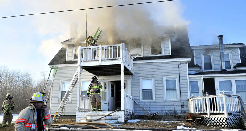 FIRE DAMAGE: Firefighters from four departments battle a fire that caused serious damage to the Charles Stubenrod home on Gogan Road in Benton on Thursday. Stubenrod said he may have accidentally caused the fire after soldering heat pipes an hour before the fire.
