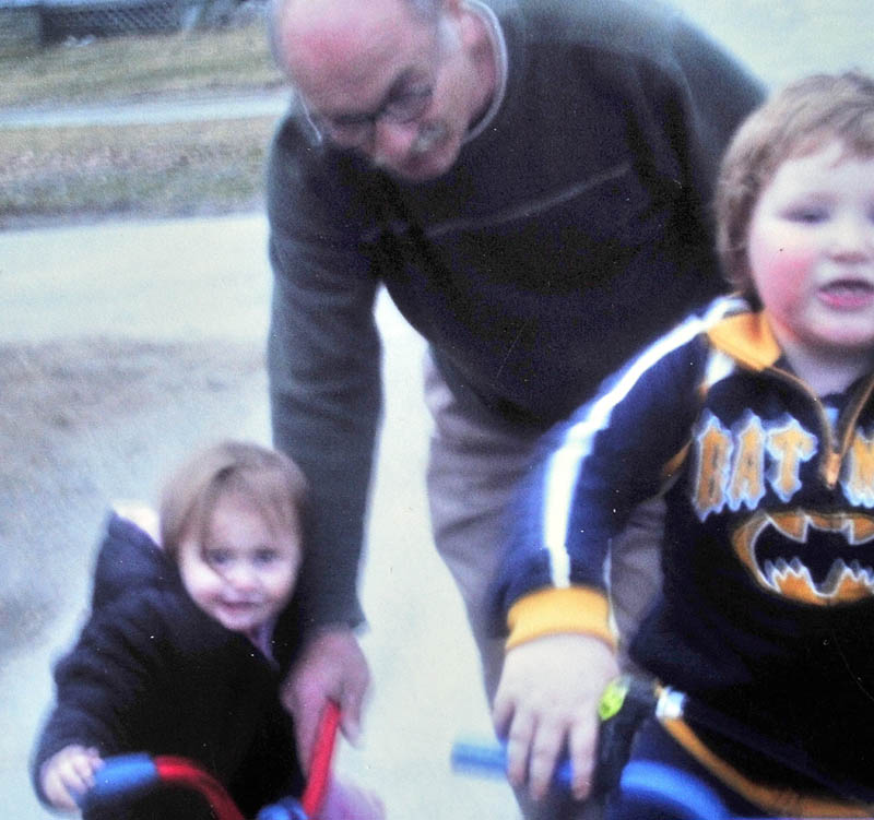 FAMILY FUN: Ernest Sayers is shown in this family photograph of him playing with grandchildren of Janice Gitschier. Sayers' body was found early Sunday in Bingham.