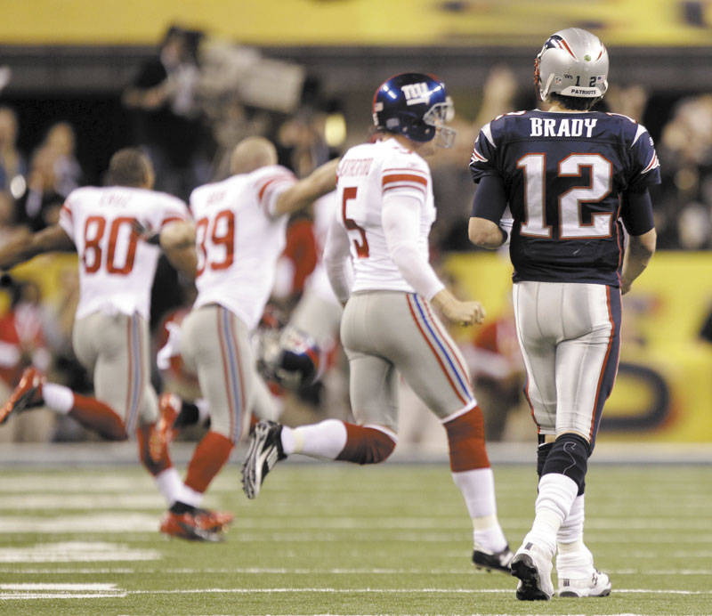 A BAD ENDING: New England Patriots quarterback Tom Brady walks off the field after the Patriots' 21-17 loss to the New York Giants in Super Bowl XLVI on Sunday in Indianapolis.