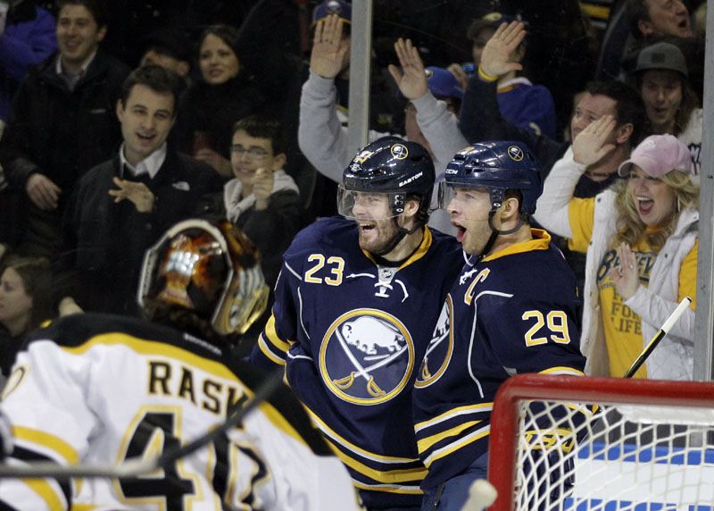 TOUGH NIGHT: Buffalo Sabres forward Jason Pominville, right, celebrates his goal with Ville Leino while Boston Bruins goalie Tuukka Rask looks on during the first period Wednesday night in Buffalo, N.Y. The Bruins lost 6-0.