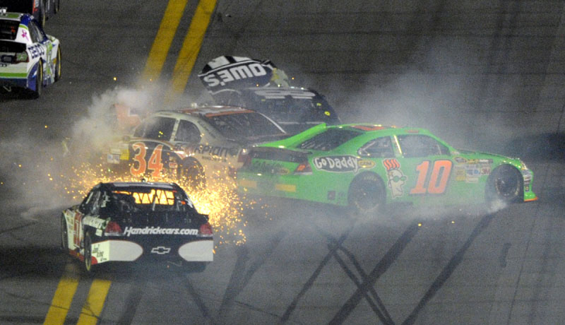 WIPEOUT: Danica Patrick (10), Kurt Busch (51), David Ragan (34) and Jimmie Johnson (48) crash during the Daytona 500 on Monday night in Daytona Beach, Fla.