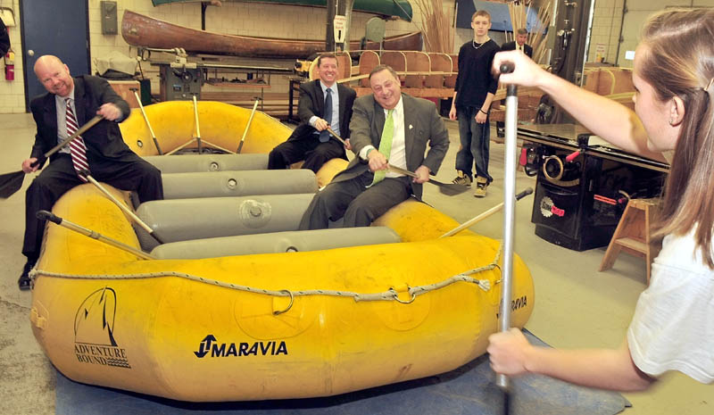 RUB A DUB DUB: Gov. Paul LePage, right, Education Commissioner Stephen Bowen, in back, and Jonathan Nass follow instructions from student Meghan Orchard on how to paddle in a whitewater raft following announcement of education policies at the Somerset Career Technical Center in Skowhegan on Wednesday.
