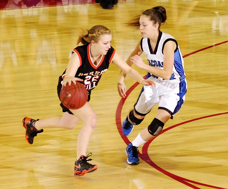 Forest Hills' Dana McNally, left, tries to get by Seacoast's Jenny English uring the Class D West tournament on Tuesday morning at the Augusta Civic Center.