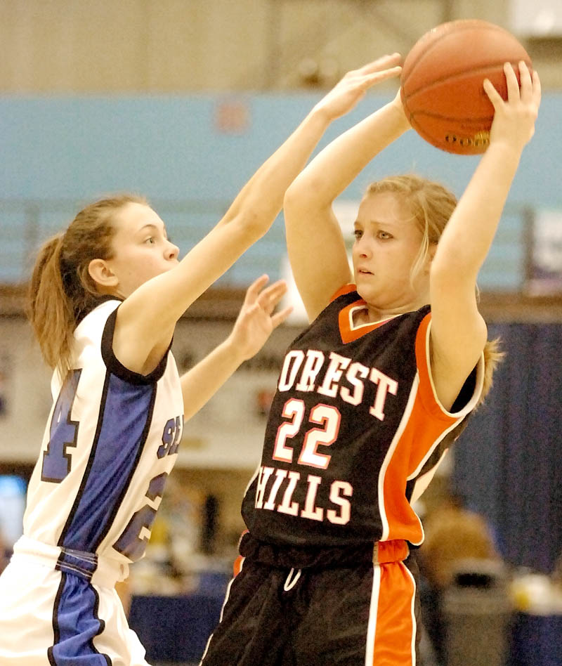 Seacoast's Jenny English, left, tries to block Forest Hills' Dana McNally during the Class D West tournament on Tuesday morning at the Augusta Civic Center.