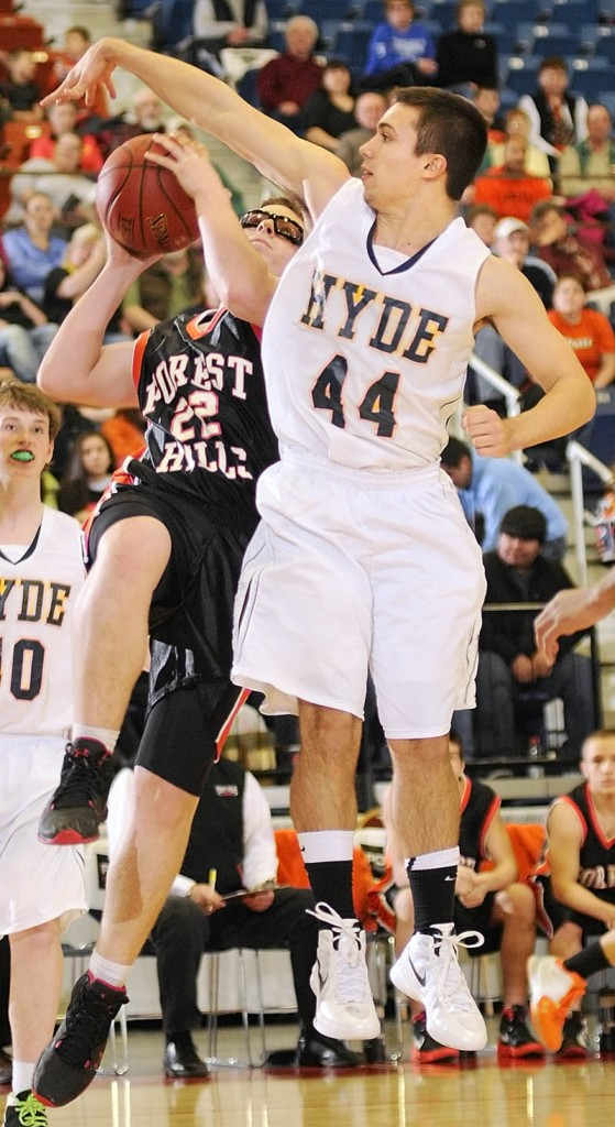 TOUGH SHOT: Forest Hills junior forward Derick Ouellette draws a foul on Hyde's Talin Rowe during their game Saturday in Augusta. Forest Hills won 61-60.