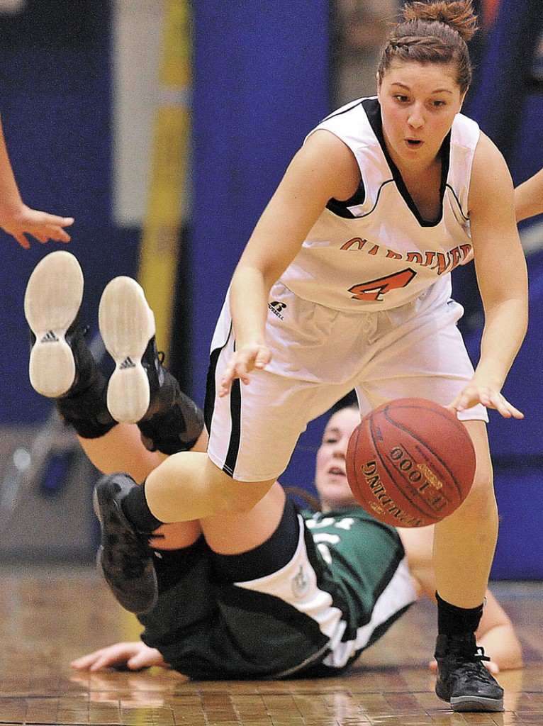 I'LL TAKE THAT: Gardiner's Kylee Granholm, front, recovers the ball after stealing it from Mount Desert Island's Hannah Shaw in the first half of an Eastern Class B quarterfinal game Saturday at the Bangor Auditorium. Gardiner defeated MDI 63-38 and plays top-ranked Presque Isle at 8:30 p.m. Wednesday.