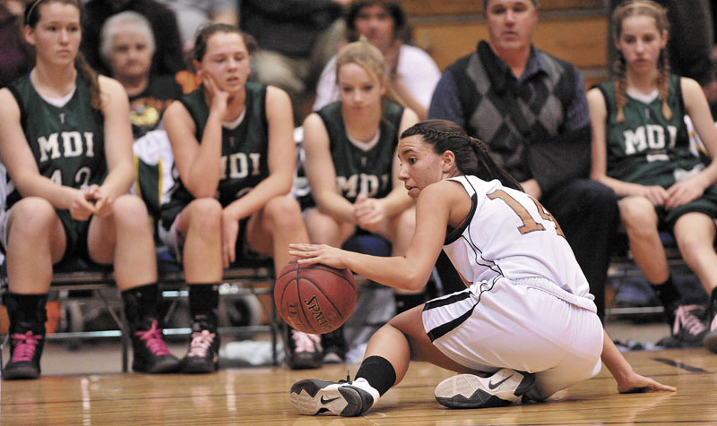 Photo by Michael G. Seamans Gardiner High School guard Jenna Moore, 14, recovers her dribble after recovering the loose ball against Mount Desert Island High School in the second half of the Eastern Class B quarterfinals game at the Bangor Auditorium Saturday. Gardiner defeated MDI 63-38.