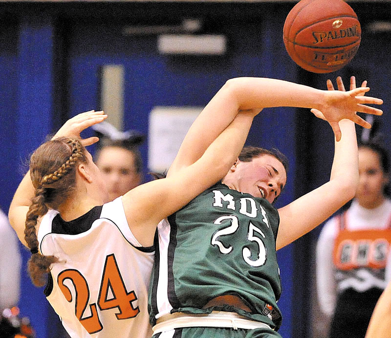 Photo by Michael G. Seamans Gardiner High School's Allyson Day, 24, left, fights for the ball with Mount Desert Island High School's Hannah Shaw, 25, right, in the second half of the Eastern Class B quarterfinals game at the Bangor Auditorium Saturday. Gardiner defeated MDI 63-38.
