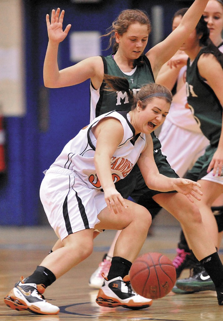 Photo by Michael G. Seamans Gardiner High School's Abby Dunn, 33, drives to the basket as Mount Desert Island High School's Molly Carrll, 13, tries to defend in the second half of the Eastern Class B quarterfinals game at the Bangor Auditorium Saturday. Gardiner defeated MDI 63-38.