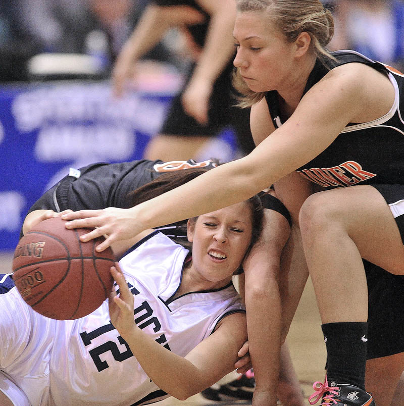 Photo by Michael G. Seamans Gardiner High School's Kelly MaComber, 22, battles for the loose ball with Presque Isle High School's Chelsea Nickerson, 12, in the first half of the Eastern Class B semi-finals at the Bangor Auditorium Wednesday.