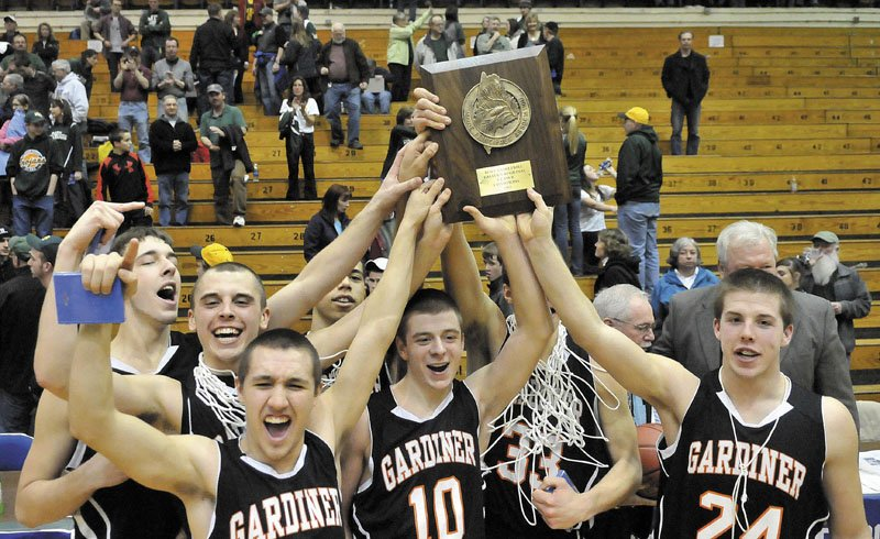 RAISE THE PLAQUE: Gardiner Area High School's (from left to right) Tyler Jamison, Jake Palmer, Travis Kelley, Justin Lovely, Aaron Toman and Matt Hall celebrate after defeating Mt. Desert Island 70-58 for the Eastern Maine Class B championship Saturday at the Bangor Auditorium.