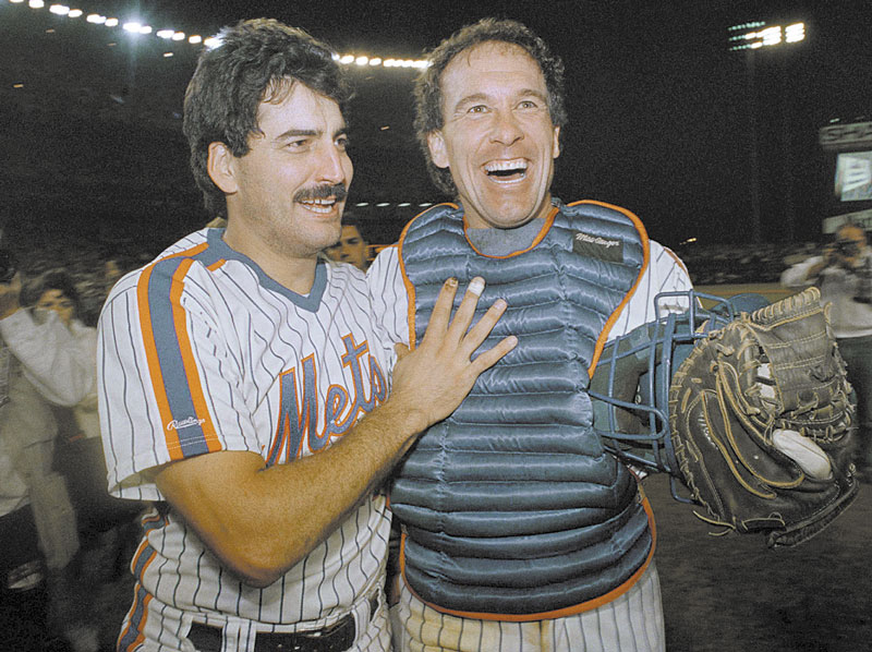GOING TO BE MISSED: New York Mets' Keith Hernandez, left, and Gary Carter are happy-looking ballplayers as they come off the field at Shea Stadium in New York after clinching the National League East title in 1988. Carter has died Thursday at age 57.