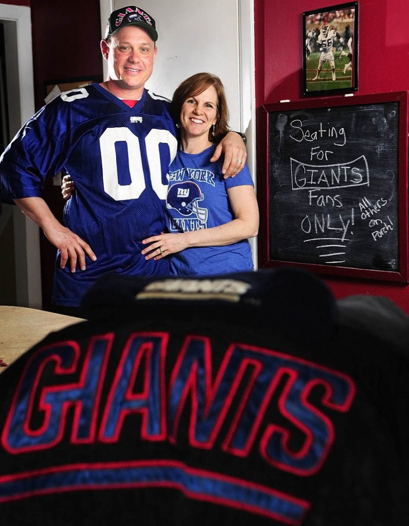 GIANTS FANS IN PATS COUNTRY: Joel and Holly Stoneton of Winthrop will be rooting for the New York Giants in Super Bowl XLVI.