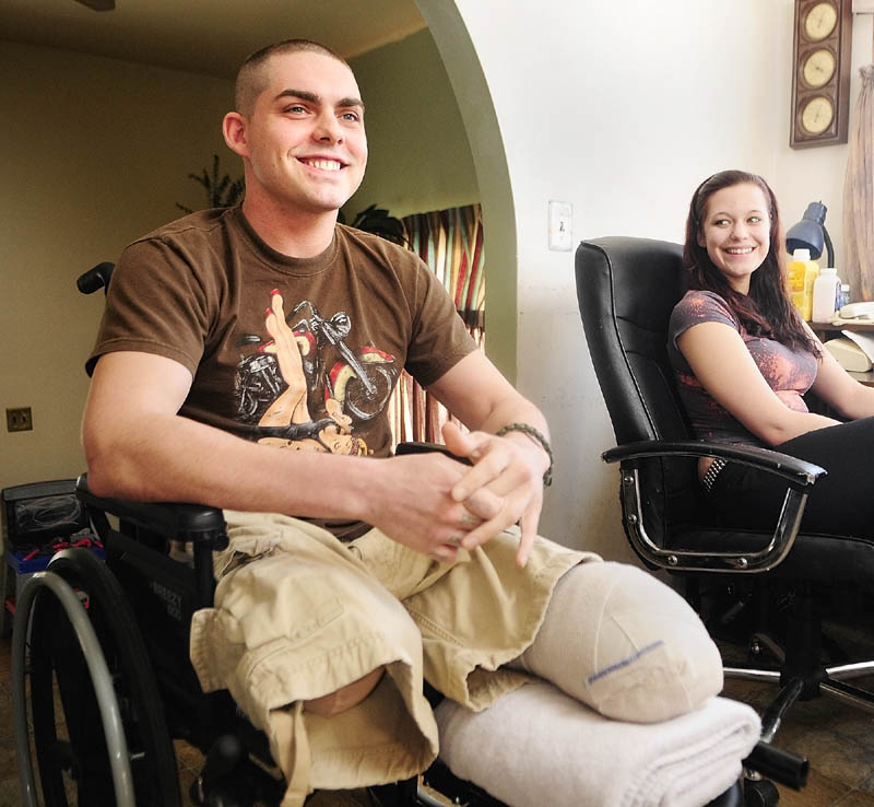 Jeremy Gilley, left, and girlfriend Rachael Turcotte answer an interviewer's questions at his parent's home in Palermo. Gilley came back from Iraq, only to be pinned between vehicles in a crash.