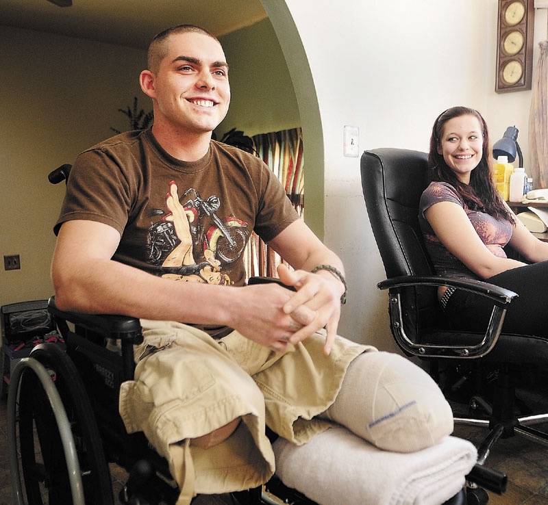 Jeremy Gilley, left, and girlfriend Rachael Turcotte, right, answer an interviewer's questions at his parent's home in Palermo. U.S. Representative Mike Michaud, of Maine, headlined a charity event for Gilley, 27, on Saturday. Gilley lost both his legs in December.