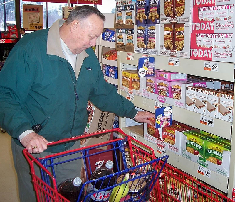 SAVING A LOT: Dwight Amos, 69, of Wilton, said he shops at the Farmington Save-A-Lot store because it's less expensive and more convenient than bigger grocery stores. A Save-A-Lot is opening this spring in downtown Waterville, according to the new store's majority owner Zak Sclar.