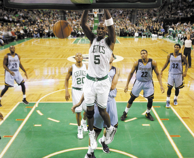 HAMMER DUNK: Boston's Kevin Garnett (5) dunks in the second half of the Celtics' 98-80 win over the Memphis Grizzlies on Sunday in Boston.