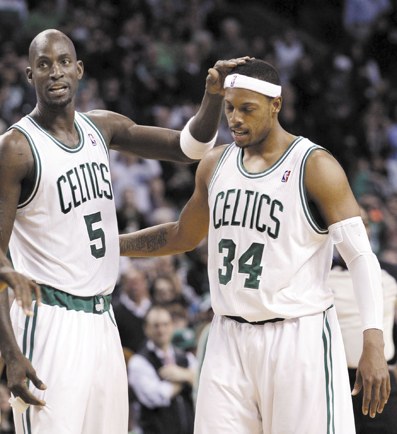 CONGRATS BUDDY: Boston Celtics forward Kevin Garnett, left, had a streak of 14 straight all-star appearances snapped when he wasn't named to the All-Star team Thursday. Teammate Paul Pierce, right, was picked as a reserve.