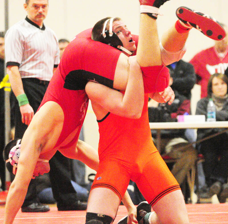 HANG ON: Camden Hills' Anthony Batty, left, and Skowhegan's Levi Hayden compete in the 182-pound finals match during the Kennebec Valley Athletic Conference meet Saturday at Cony High School in Augusta. Batty pinned Hayden to win the match.