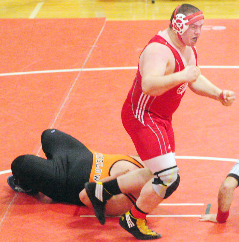 TITLE-WINNING MATCH: Cony's Steven Morse jumps up and celebrates after pinning Winslow's Aaron Lint during the 285-pound finals match at the Kennebec Valley Athletic Conference meet Saturday at Cony High School in Augusta. The pin put the Rams over to top to win the Class A title by one point.